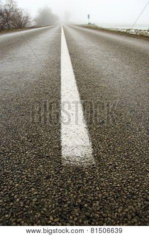 Empty Rural Asphalt Road In Autumn Mist