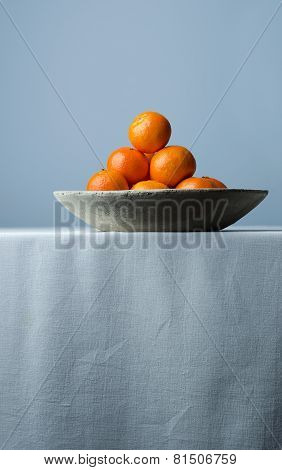 Clementines In A Ceramic Bowl