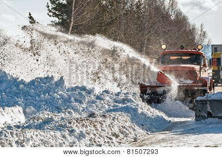 Snowplow removes snow