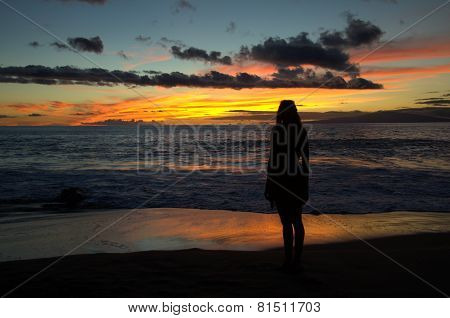 Girl standing at beach Maui Sunset