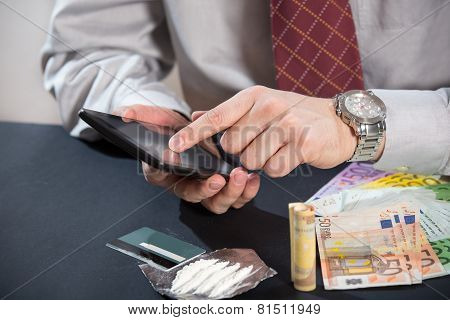 Loan shark with gun, money, drugs and tablet pc