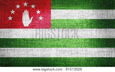 Abkhazia flag on burlap fabric