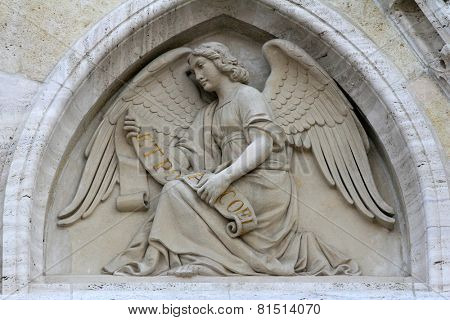 ZAGREB, CROATIA - SEPT 25: Angel on the portal of the cathedral dedicated to the Assumption of Mary and to kings Saint Stephen and Saint Ladislaus in Zagreb on Sept 25, 2013.