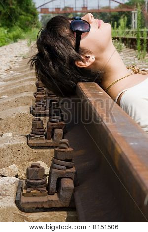 Girl Laying On The Railroad Carelessly