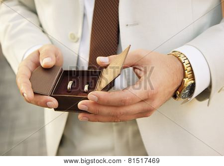 groom with wedding rings