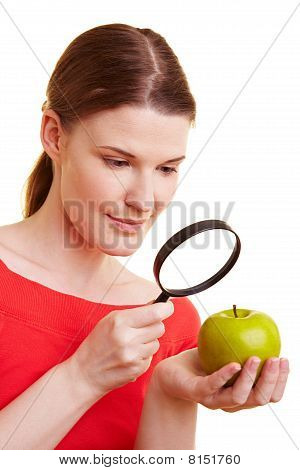 Woman Watching Apple With Magnifying Glass