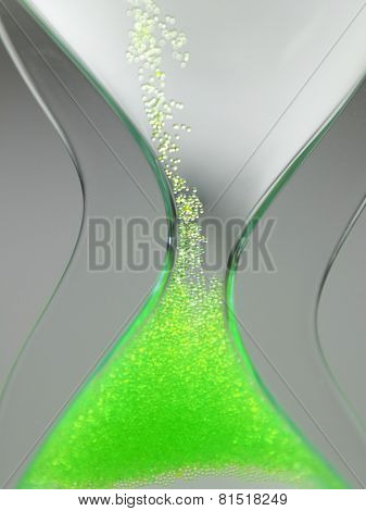 green liquid type of hour-glass