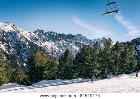 Ski slope with chair lift and winter mountains panorama., resort Bansko, Bulgaria