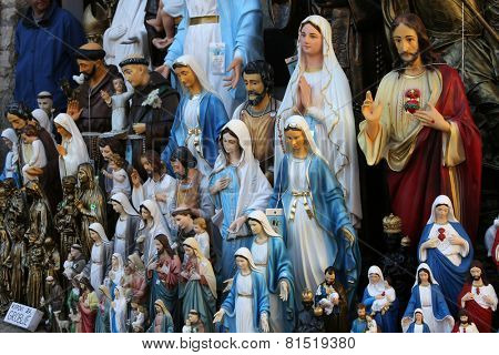 MARIJA BISTRICA, CROATIA - OCTOBER 26, 2013: Catholic Religious items, figurines of saints in one of the Souvenir shops in  pilgrimage Sanctuary Assumption of the Virgin Mary