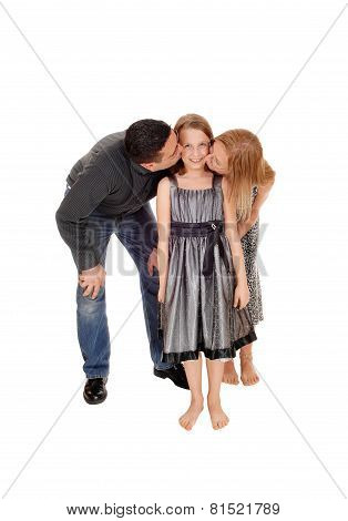 Parents Kissing There Daughter.