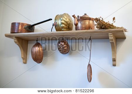 Kitchen Shelf With Old Copper Utensils