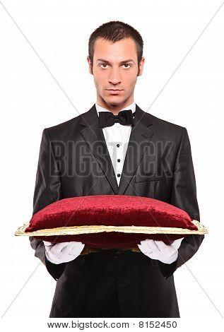 Man holding a pillow