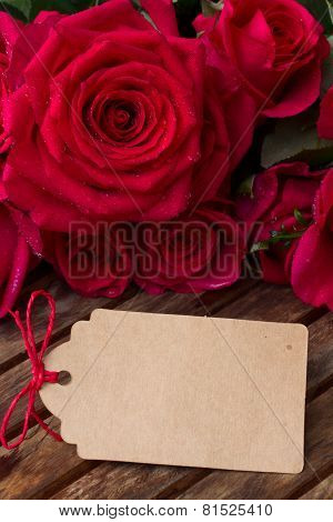 dark pink  roses with hearts and tag