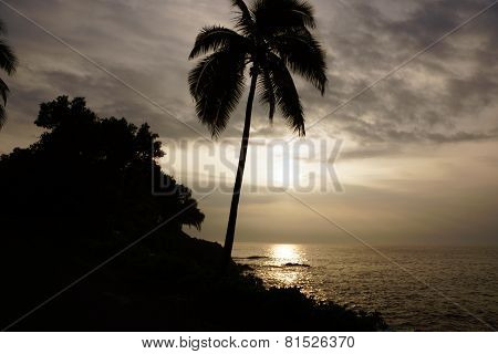 Sunrise Over The Ocean With Waves Crashing Along Rocky Shore