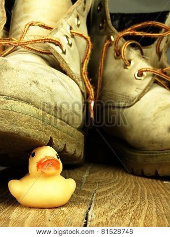 Rubber Duck Crushed By A Heavy, Old Military Boot.