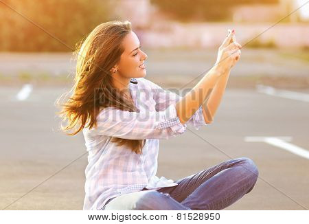 Lifestyle Portrait Happy Beautiful Woman Doing A Self-portrait On The Smartphone Outdoors Evening On