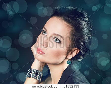 Portrait Of A Girl. Blinking Background. Bokeh