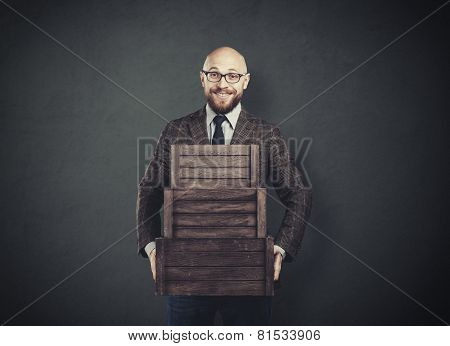 Cheerful Man Holding Boxes