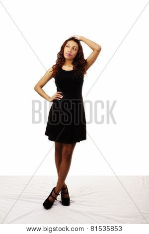 Attractive Latina Woman Standing Black Dress Arm On Head