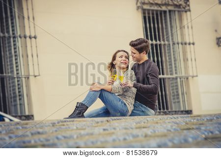 Young Beautiful Couple In Love On Street Together Celebrating Valentines Day With Champagne Toast