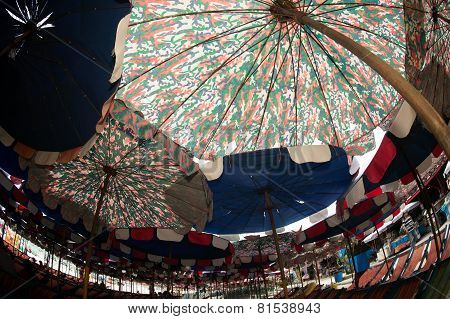 Beach Umbrella On The White Sand. Tropical Paradise On The Shores Of The Sea.