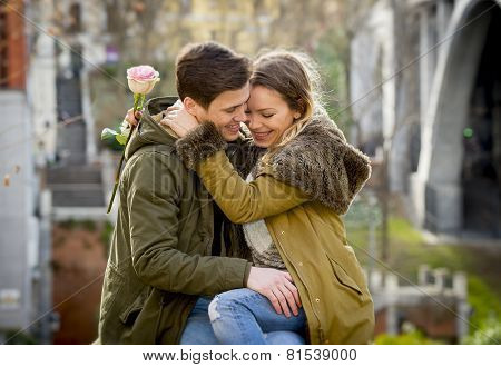 Couple With Rose In Love Kissing On Street Alley Celebrating Valentines Day With Passion Sitting On