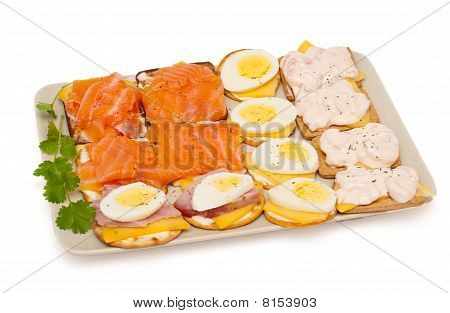 Cheese, Salmon, Egg, Prawns, Ham Appetizer Crackers Isolated On White