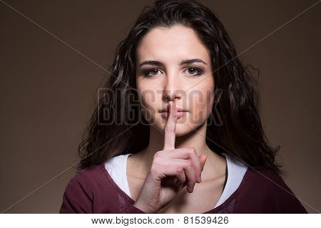 Beautiful Girl Making Silence Gesture