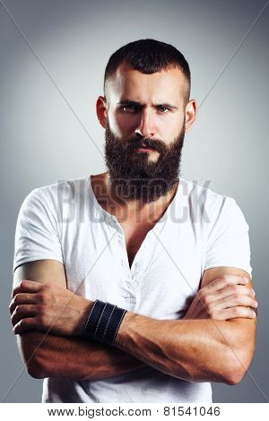 Portrait of handsome bearded man isolated on grey background