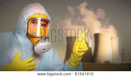 Man in protective suit with gas mask alerting against air pollution.