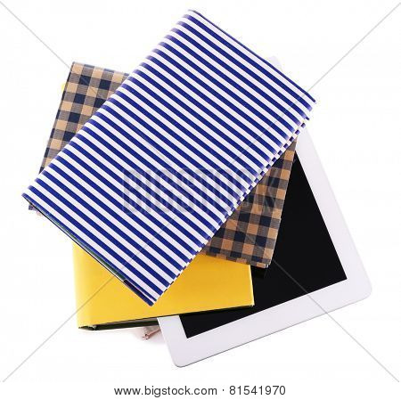Pile of books with tablet isolated on white