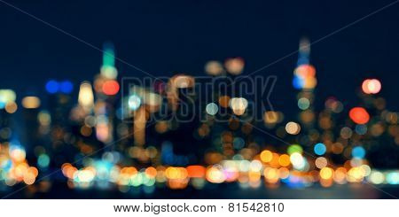Midtown Manhattan skyline bokeh at dusk panorama over Hudson River