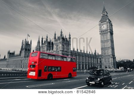 Double-deck red bus on Westminster Bridge with Big Ben in London.