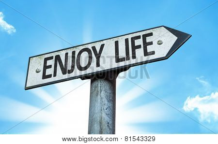 Enjoy Life sign with a beautiful day