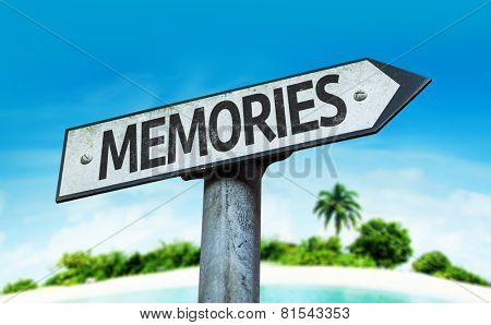 Memories sign with a beach on background