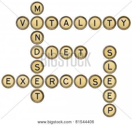 vitality, diet, mindset, sleep and exercise crossword in old round typewriter keys isolated on white