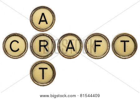 art and craft crossword in old round typewriter keys isolated on white