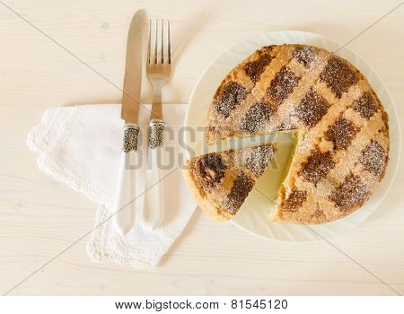 Neapolitan Easter Pie With Wheat And Ricotta On White Wooden Table