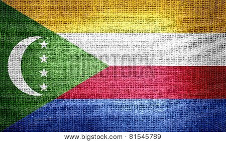 Comoros flag on burlap fabric