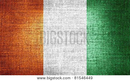 Ivory Coast flag on burlap fabric