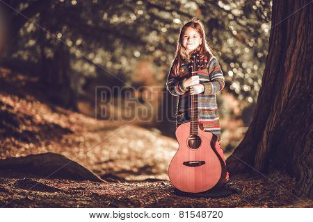 Girl And Guitar In The Park