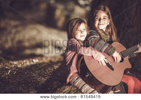 Young Girls Playing Guitar