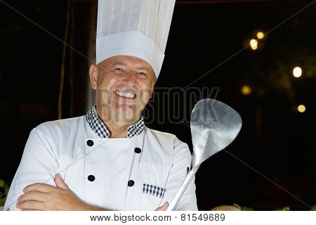 Cheerful chef cook of Seafood restaurant