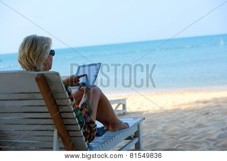 Relaxing woman in sun lounge