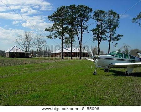 Beechcraft airplane on rural landing strip