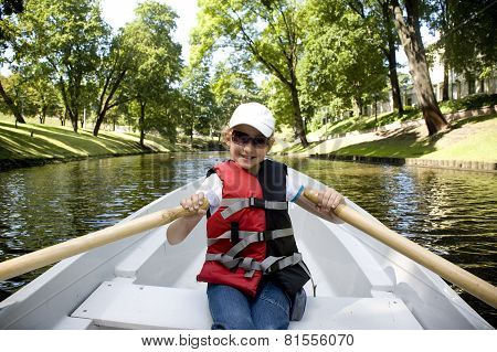The Girl In The Boat On Oars On The Channel