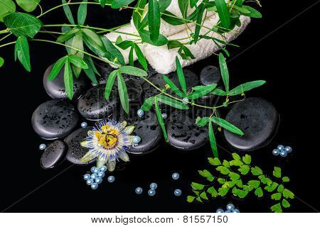 Spa Background Of Passiflora Flower, Branches, Towels, Zen Basalt Stones With Drops And Pearl Beads