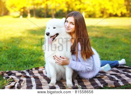 Pretty Happy Woman And Dog Outdoors In The Park