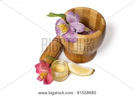 Wooden bamboo pounder with honey and flowers
