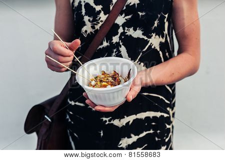 Young Woman With Bowl Of Squid